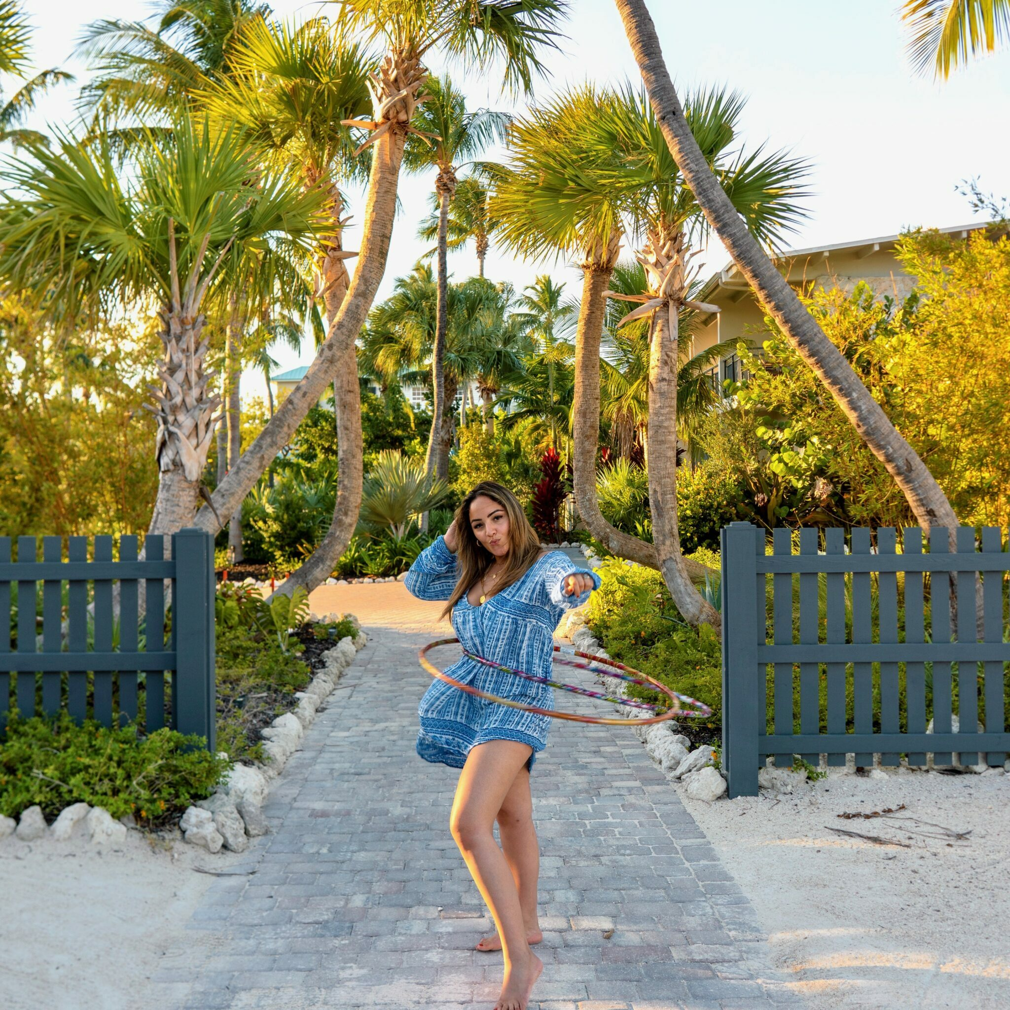 islamorada itinerary girl hoola hooping on the beach with palm trees in the background